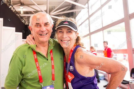 Kathrine Switzer and her husband, runner and journalist Roger Robinson, pose for a photo at the media center after the marathon