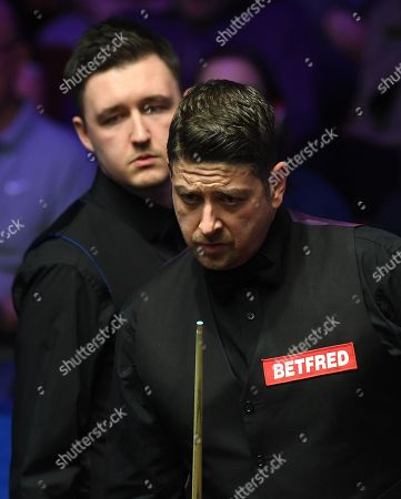 Kyren Wilson of England and Matthew Stevens of Wales (right) during their first round match