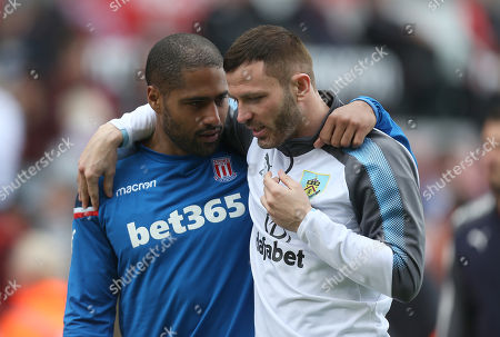 Stoke City's Glen Johnson shares a moment with Burnley's Phil Bardsley