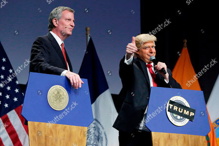 "Stock Image of Anthony Atamanuik, Bill de Blasio. New York Mayor Bill de Blasio, left, performs with Donald Trump impersonator Anthony Atamanuik, during the mayor's response to ""Curb Your Narcissism,"" the 95th annual Inner Circle Show, in New York, . The charity event features New York City's political reporters who spoof the president, the mayor, and politicians"