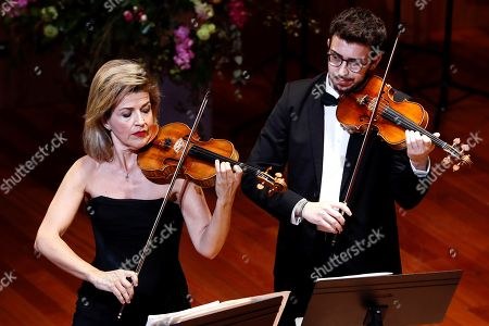 Stock Picture of German violinist Anne Sophie Mutter (L) performs on stage during the 4th Meeting of International High Music School Reina Sofia, in Madrid, Spain, 22 April 2018.