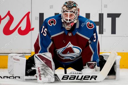 Colorado Avalanche goaltender Andrew Hammond stretches during warmups in Game 6 of an NHL hockey first-round playoff series against the Nashville Predators, in Denver