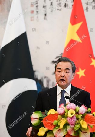 Stock Image of Chinese Foreign Minister Wang Yi speaks during a press conference with Pakistan's Foreign Minister Khawaja Muhammad Asif, left, after their meeting at the Diaoyutai State Guest House in Beijing, China