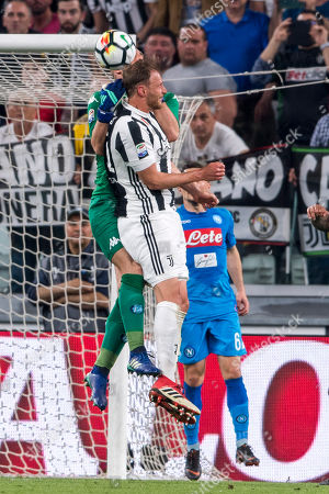 Benedikt Howedes of Juventus and Jose Reina of Napoli