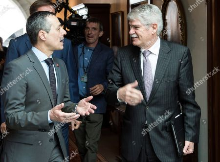 Swiss Federal Councillor Ignazio Cassis (L) welcomes Spanish Foreign Minister Alfonso Maria Dastis Quecedo (R) in Bern, Switzerland, 23 April 2018. Dastis Quecedo is on an official working visit in Switzerland.