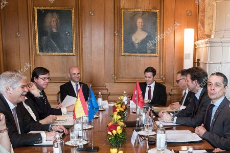 Swiss Federal Councillor Ignazio Cassis (R) and Spanish Foreign Minister Alfonso Maria Dastis Quecedo (L) sit for a meeting in Bern, Switzerland, 23 April 2018. Dastis Quecedo is on an official working visit in Switzerland.