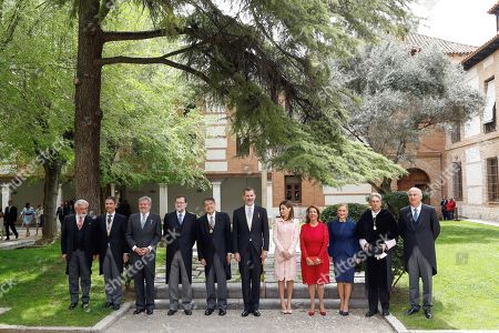 King Felipe VI of Spain (6L) and Queen Letizia of Spain (5R) pose with Nicaraguan writer Sergio Ramirez (5L) and his wife, Gertrudis Guerrero Mayorga (4R), director of the Spanish Royal Language Academy, Dario Villanueva (L); mayor of Alcala de Henares, Javier Rodriguez (2-L); Spanish Minister of Culture, Inigo Mendez de Vigo; Spanish Prime Minister, Mariano Rajoy (4-L); Madrid's regional President, Cristina Cifuentes (3-R); rector of Alcala de Henares University, Jose Vicente Saz (2-R), and junior Minister of Culture, Fernando Benzo (R), after the Awarding Ceremony of the Cervantes Award 2017 in Alcala de Henares, Madrid, Spain, 23 April 2018. Ramirez was awarded with the Cervantes Award.