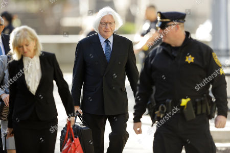 Attorneys Tom Mesereau, center, and Kathleen Bliss arrives for Bill Cosby's sexual assault trial, at the Montgomery County Courthouse in Norristown, Pa