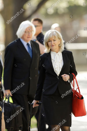 Attorneys Kathleen Bliss, right, and Tom Mesereau arrive for Bill Cosby's sexual assault trial, at the Montgomery County Courthouse in Norristown, Pa