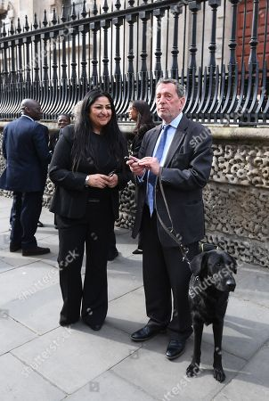 Stock Image of Blind former British Labour Education Minister, David Blunkett (R) leaves after attending the memorial service to commemorate the 25th anniversary of the murder of Stephen Lawrence in St Martins in the Field, central London, Britain, 23 April 2018. Stephen was stabbed to death by a group of six white youths in an unprovoked racist attack as he waited at a bus stop on Well Hall Road in Eltham, London, Britain on 22 April 1993. Prince Harry read a message of support on behalf of The Prince of Wales during the service.