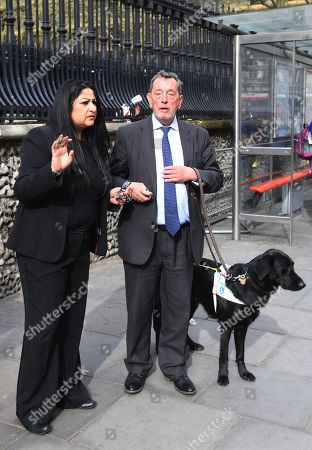 Blind former British Labour Education Minister, David Blunkett (R) leaves after attending the memorial service to commemorate the 25th anniversary of the murder of Stephen Lawrence in St Martins in the Field, central London, Britain, 23 April 2018. Stephen was stabbed to death by a group of six white youths in an unprovoked racist attack as he waited at a bus stop on Well Hall Road in Eltham, London, Britain on 22 April 1993. Prince Harry read a message of support on behalf of The Prince of Wales during the service.