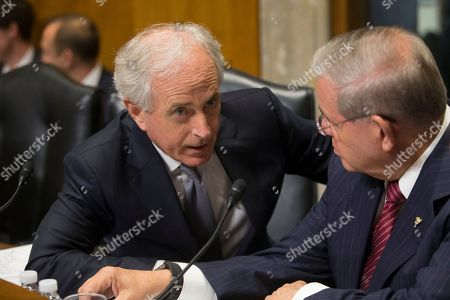Chairman of the Senate Foreign Relations Committee Republican Bob Corker (L) speaks with the committee's  Ranking Member Democratic Senator from New Jersey Bob Menendez (R), before the start of the committee's business meeting to consider the nomination of CIA Director Mike Pompeo to be Secretary of State, on Capitol Hill in Washington, DC, USA, 23 April 2018. If confirmed by the full Senate, Pompeo would fill the vacancy left after US President Donald J. Trump fired Rex Tillerson.