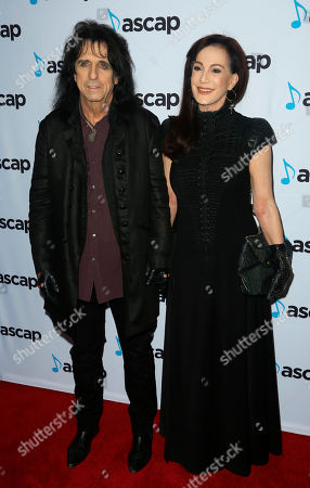 Stock Picture of Alice Cooper, Sheryl Goddard. Alice Cooper, left, and Sheryl Goddard arrive at the 2018 ASCAP Pop Music Awards at The Beverly Hilton, in Beverly Hills, Calif