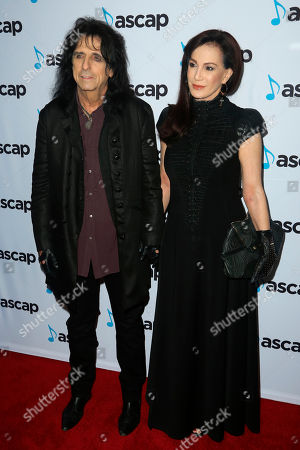 Stock Image of Alice Cooper, Sheryl Goddard. Alice Cooper, left, and Sheryl Goddard arrive at the 2018 ASCAP Pop Music Awards at The Beverly Hilton, in Beverly Hills, Calif