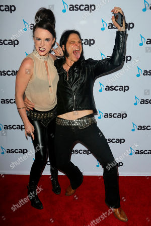 Calico Cooper, Chuck Garric. Calico Cooper, left, and Chuck Garric arrive at the 2018 ASCAP Pop Music Awards at The Beverly Hilton, in Beverly Hills, Calif