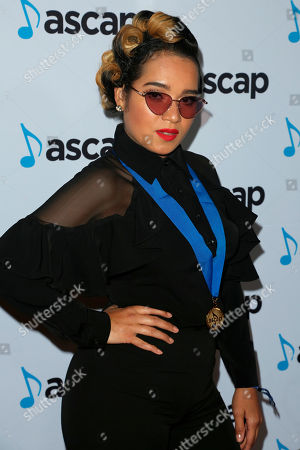 Lumidee, Lumidee Cedeno. Lumidee arrives at the 2018 ASCAP Pop Music Awards at The Beverly Hilton, in Beverly Hills, Calif