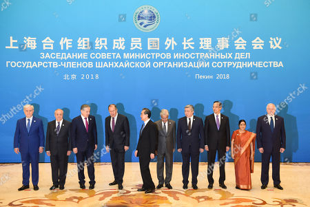 Stock Picture of (L-R) SCO Secretary-General Rashid Alimov, Uzbek Foreign Minister Abdulaziz Kamilov, Tajik Foreign Minister Sirodjidin Aslov, Russian Foreign Minister Sergei Lavrov, Chinese State Councilor and Foreign Minister Wang Yi, Pakistan Foreign Minister Khawaja Muhammad Asif, Kyrgyz Foreign Minister Erlan Abdyldaev, Kazakh Foreign Minister Kairat Abdrakhmanov, Indian Foreign Minister Sushma Swaraj, SCO Regional Anti-Terrorist Structure Director Yevgeniy Sergeyevich Sysoyev prepare to pose for a photo before a meeting of foreign ministers and officials of the Shanghai Cooperation Organisation (SCO) at the Diaoyutai State Guest House in Beijing, China, 24 April 2018.