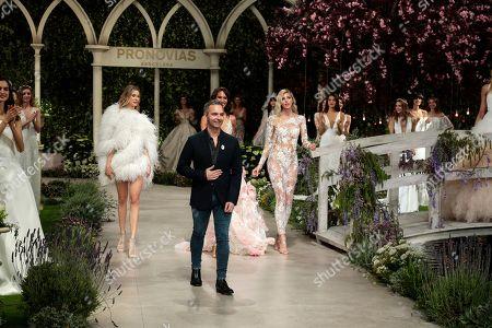 Designer director Herve Moreau and models on the catwalk