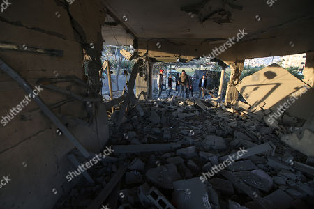Palestinians inspect the damaged house of Palestinian prisoner Ahmad Jamal al-Qumbaa after it was demolished by Israeli troops in the West Bank City of Jenin, 24 April 2018. According to reports, Israeli forces demolished the house belonging to al-Qumbaa who is allegedly involved in an attack in January near Nablus city in which an Israeli settler was killed. Clashes erupted between Palestinians and Israeli forces during the demolishing.
