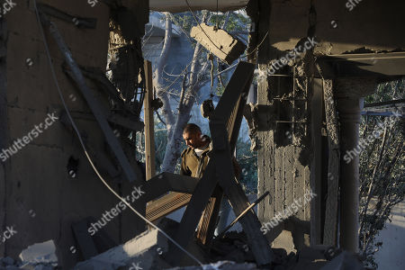 A Palestinian man walks between the rubble of demolished house of Palestinian prisoner Ahmad Jamal al-Qumbaa after it was demolished by Israeli troops in the West Bank City of Jenin, 24 April 2018. According to reports, Israeli forces demolished the house belonging to al-Qumbaa who is allegedly involved in an attack in January near Nablus city in which an Israeli settler was killed. Clashes erupted between Palestinians and Israeli forces during the demolishing.