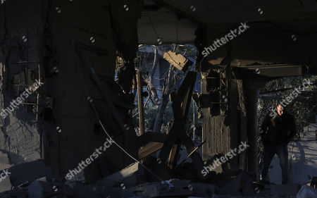 Stock Picture of A Palestinian man walks between the rubble of demolished house of Palestinian prisoner Ahmad Jamal al-Qumbaa after it was demolished by Israeli troops in the West Bank City of Jenin, 24 April 2018. According to reports, Israeli forces demolished the house belonging to al-Qumbaa who is allegedly involved in an attack in January near Nablus city in which an Israeli settler was killed. Clashes erupted between Palestinians and Israeli forces during the demolishing.