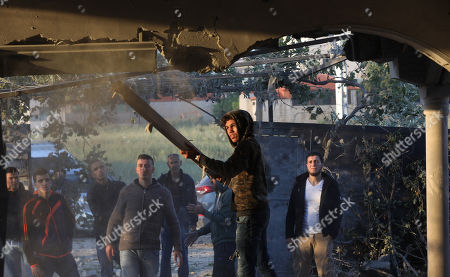 Stock Image of Palestinians inspect the damaged house of Palestinian prisoner Ahmad Jamal al-Qumbaa after it was demolished by Israeli troops in the West Bank City of Jenin, 24 April 2018. According to reports, Israeli forces demolished the house belonging to al-Qumbaa who is allegedly involved in an attack in January near Nablus city in which an Israeli settler was killed. Clashes erupted between Palestinians and Israeli forces during the demolishing.