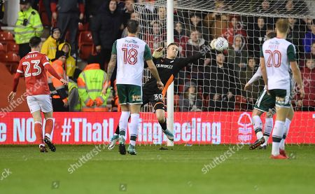 Barnsley keeper Jack Walton makes his debut but cannot stop 3 Forest goals.