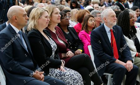 Sajid Javid, Secretary of State for Housing, left, with Karen Bradley Secretay of State for Northern Ireland, Amber Rudd Home Secretary, Labour MP Diane Abbott, Labour Party leader Jeremy Corbyn, second right and Labour MP Dawn Butler, right, watch the unveiling a statue of Millicent Fawcettin Parliament Square, London, . Britain's Prime Minister Theresa May has helped unveil a statue of women's rights campaigner Millicent Fawcett outside Britain's Parliament. Fawcett is the first woman to be commemorated there alongside 11 statues of men including Nelson Mandela and Winston Churchill