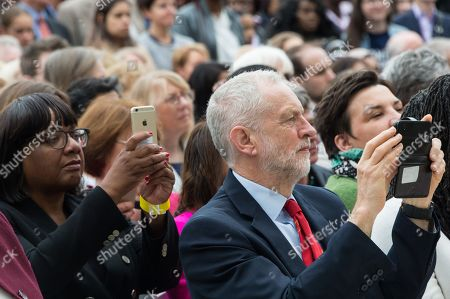 Stock Image of Diane Abbott MP and Jeremy Corbyn MP, Leader of the Labour Party use their mobile phones at the statue unveiling of the Suffragist leader Millicent Fawcett in Parliament Square. The Mayor of London commissioned Turner prize-winning artist Gillian Wearing Obe to create the statue.