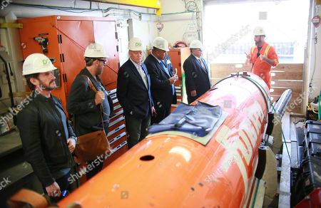 DeepGreen CEO Gerard Barron and ISA President Michael Lodge inspect the Autonomous Underwater Vehicle that will descend four kilometers below the Pacific to look for metals for our future, in San Diego. Others include: Greg Stone, DeepGreen Board Member, Hon. Milton Dube and President Baron Waqa