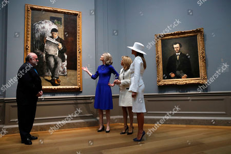 Melania Trump, Brigitte Macron, Mary Morton, Frank Kelly. First lady Melania Trump, right, and Brigitte Macron, wife of French President Emmanuel Macron, tour the National Gallery of Art, with Mary Morton, center, and Frank Kelly, far left, in Washington