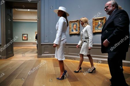 Stock Image of Melania Trump, Brigitte Macron, Frank Kelly. First lady Melania Trump, left, and Brigitte Macron, wife of French President Emmanuel Macron, tour the Cezanne exhibit at the National Gallery of Art, in Washington. At right is Frank Kelly, with the museum