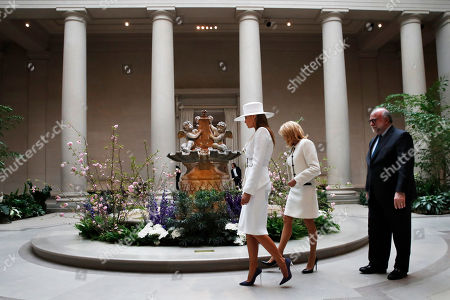 Melania Trump, Brigitte Macron, Frank Kelly. First lady Melania Trump, left, and Brigitte Macron, wife of French President Emmanuel Macron, tour the National Gallery of Art, in Washington. At right is Frank Kelly, with the museum