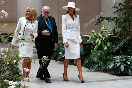Stock Picture of Melania Trump, Brigitte Macron, Frank Kelly. First lady Melania Trump, right, and Brigitte Macron, wife of French President Emmanuel Macron, left, tour the National Gallery of Art with the museum's Frank Kelly, in Washington