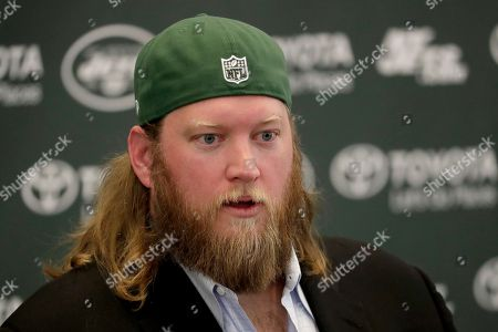 New York Jets center Nick Mangold officially retires during an NFL football news conference, in Florham Park, N.J. Mangold announced his retirement a week earlier in a post on Twitter. He was selected to seven Pro Bowls and was twice a first-team All-Pro during his 11-year career