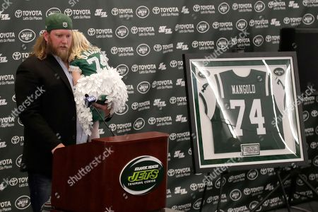 New York Jets center Nick Mangold, holding his 3-year-old daughter, Eloise, officially retires during an NFL football news conference, in Florham Park, N.J. Mangold announced his retirement a week earlier in a post on Twitter. He was selected to seven Pro Bowls and was twice a first-team All-Pro during his 11-year career