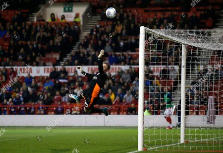 Barnsley's Jack Walton makers a flying save