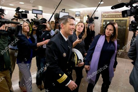 US Navy Rear Admiral Ronny Jackson (C), US President Donald J. Trump's nominee to be Secretary of Veteran Affairs, is followed by members of the news media following a meeting in the office of Republican Senator from Kansas Jerry Moran, on Capitol Hill in Washington, DC, USA, 24 April 2018. The Senate Veterans Affairs Committee has postponed Jackson's confirmation hearing amid allegations involving his behavior as a White House physician. If confirmed by the Senate, Jackson would fill the vacancy left by the exit of David Shulkin.