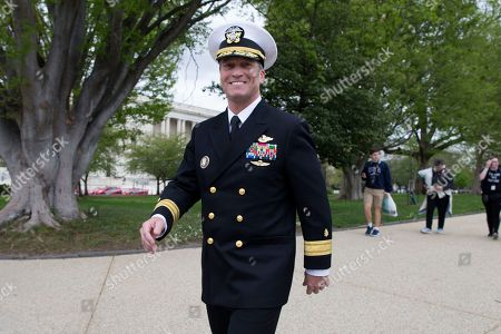Stock Picture of US Navy Rear Admiral Ronny Jackson, US President Donald J. Trump's nominee to be Secretary of Veteran Affairs, walks on Capitol Hill following a meeting in the office of Republican Senator from Kansas Jerry Moran, in Washington, DC, USA, 24 April 2018. The Senate Veterans Affairs Committee has postponed Jackson's confirmation hearing amid allegations involving his behavior as a White House physician. If confirmed by the Senate, Jackson would fill the vacancy left by the exit of David Shulkin.