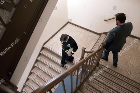 Stock Photo of US Navy Rear Admiral Ronny Jackson (L), US President Donald J. Trump's nominee to be Secretary of Veteran Affairs, walks down a stairwell in the Russell Senate Office Building following a meeting in the office of Republican Senator from Kansas Jerry Moran, on Capitol Hill in Washington, DC, USA, 24 April 2018. The Senate Veterans Affairs Committee has postponed Jackson's confirmation hearing amid allegations involving his behavior as a White House physician. If confirmed by the Senate, Jackson would fill the vacancy left by the exit of David Shulkin.
