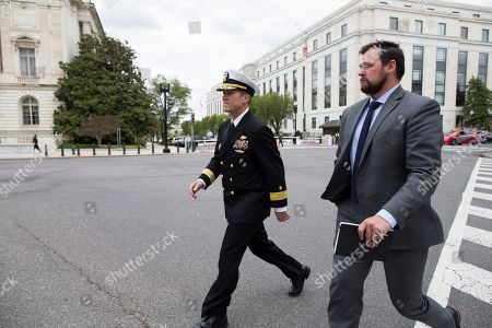 Stock Image of US Navy Rear Admiral Ronny Jackson (L), US President Donald J. Trump's nominee to be Secretary of Veteran Affairs, walks on Capitol Hill following a meeting in the office of Republican Senator from Kansas Jerry Moran, in Washington, DC, USA, 24 April 2018. The Senate Veterans Affairs Committee has postponed Jackson's confirmation hearing amid allegations involving his behavior as a White House physician. If confirmed by the Senate, Jackson would fill the vacancy left by the exit of David Shulkin.