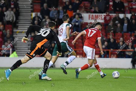 Nottingham Forest forward Ben Brereton (17) beats Barnsley goalkeeper Jack Walton (30) to score a goal making it 2-0 during the EFL Sky Bet Championship match between Nottingham Forest and Barnsley at the City Ground, Nottingham. Picture by Jon Hobley