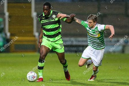 Forest Green Rovers Isaiah Osbourne(34) holds off Yeovil Town's Jared Bird(4) during the EFL Sky Bet League 2 match between Yeovil Town and Forest Green Rovers at Huish Park, Yeovil. Picture by Shane Healey