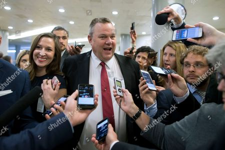 Democratic Senator from Montana and ranking member of the Senate Committee on Veterans' Affairs Jon Tester (C) is followed by members of the news media at the Senate subway on Capitol Hill in Washington, DC, USA, 24 April 2018. The Senate Veterans Affairs Committee has postponed the confirmation hearing of Ronny Jackson amid allegations involving his behavior as a White House physician. If confirmed by the Senate, Jackson would fill the vacancy left by the exit of David Shulkin.