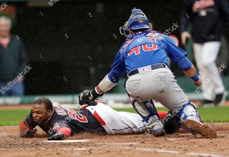 Willson Contreras, Rajai Davis. Cleveland Indians' Rajai Davis, left, is tagged out by Chicago Cubs catcher Willson Contreras in the third inning of a baseball game, in Cleveland