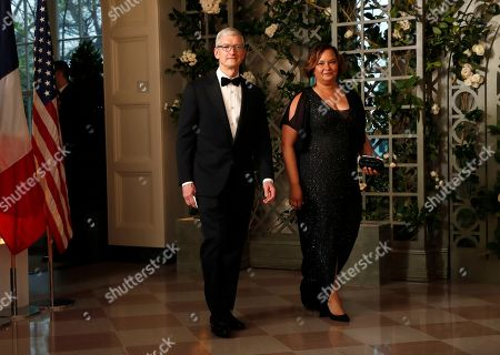 Tim Cooke, Lisa Jackson. Apple CEO Tim Cooke and former EPA administrator Lisa Jackson arrive for a State Dinner with French President Emmanuel Macron and President Donald Trump at the White House, in Washington