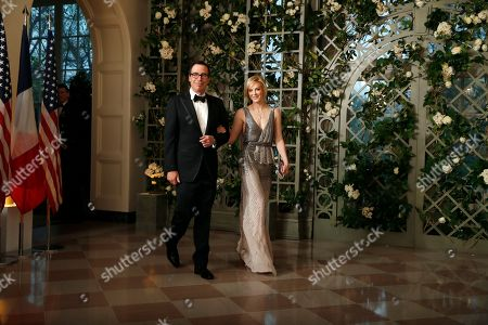 Steve Mnuchin, Louise Linton. Treasury Secretary Steve Mnuchin and his wife Louise Linton arrive for a State Dinner with French President Emmanuel Macron and President Donald Trump at the White House, in Washington