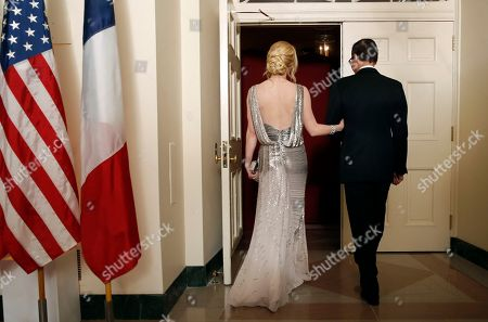 Steve Mnuchin, Louise Linton. Treasury Secretary Steve Mnuchin and his wife Louise Linton head into a State Dinner with French President Emmanuel Macron and President Donald Trump at the White House, in Washington