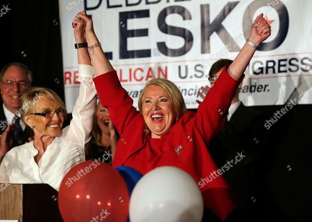 Republican U.S. Congressional candidate Debbie Lesko, right, celebrates her win with former Arizona Gov. Jan Brewer at her home, in Peoria, Ariz. Lesko ran against Democratic candidate Hiral Tipirneni for Arizona's 8th Congressional District seat being vacated by U.S. Rep. Trent Franks, R-Arizona