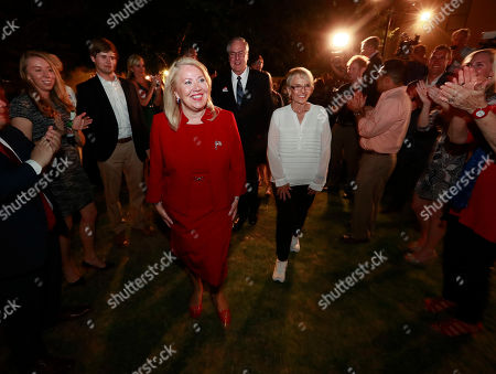 Republican U.S. Congressional candidate Debbie Lesko, front left, walks to the stage with former Arizona Gov. Jan Brewer after her congressional win, at her home in Peoria, Ariz. Lesko ran against Democratic candidate Hiral Tipirneni for Arizona's 8th Congressional District seat being vacated by U.S. Rep. Trent Franks, R-Arizona
